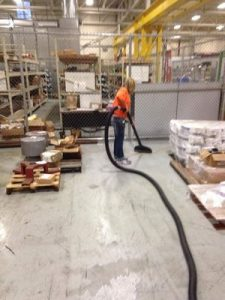 Water Damage Marpole Technician Cleaning After Warehouse Flooding