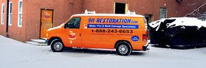 Water Damage Restoration Van At Snowy Civic Job Site