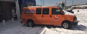 Water Damage Restoration Van In Snow At Commercial Job Site